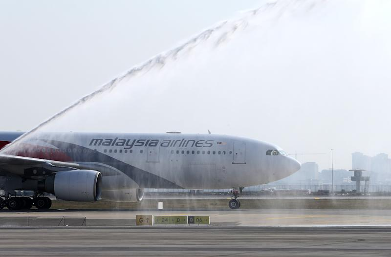 A Malaysia Airlines plane is welcomed by traditional water salute at the Istanbul Sabiha Gokcen International Airport.