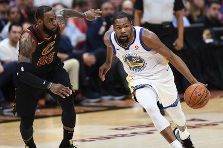 Jun 8, 2018; Cleveland, OH, USA; Golden State Warriors forward Kevin Durant (35) dribbles against Cleveland Cavaliers forward LeBron James (23) during the first quarter in game four of the 2018 NBA Finals at Quicken Loans Arena. Ken Blaze-USA TODAY Sports