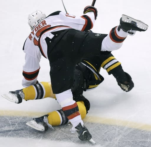 New Jersey Devils right wing Michael Ryder (17) and Boston Bruins defenseman Dennis Seidenberg (44), of Germany, collide during the first period of an NHL hockey game in Boston, Monday, Nov. 10, 2014. (AP Photo/Charles Krupa)