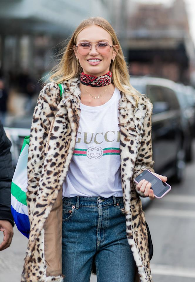 <p>Dutch model Romee Strijd wore the white logo T-shirt with a leopard jacket and denim jeans during New York Fashion Week in 2017. (Photo: Getty Images) </p>
