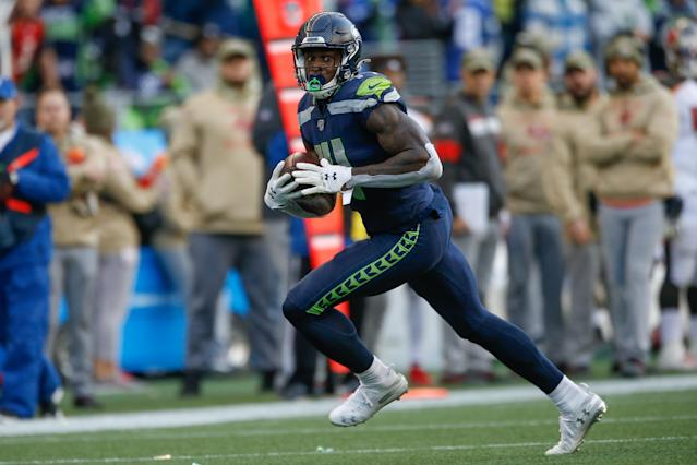 Receiver DK Metcalf #14 of the Seattle Seahawks rushes for a touchdown in the second half against the Tampa Bay Buccaneers at CenturyLink Field on November 3, 2019 in Seattle, Washington. The Seahawks beat the Buccaneers 40-34 in overtime. (Photo by Otto Greule Jr/Getty Images)