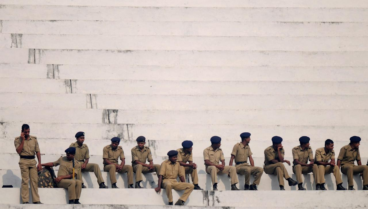 CUTTACK, INDIA - FEBRUARY 01:  Police officers watch the second match of ICC Womens World Cup between Australia and Pakistan, played at the Barabati stadium on February 1, 2013 in Cuttack, India.  (Photo by Pal Pillai-ICC/ICC via Getty Images)