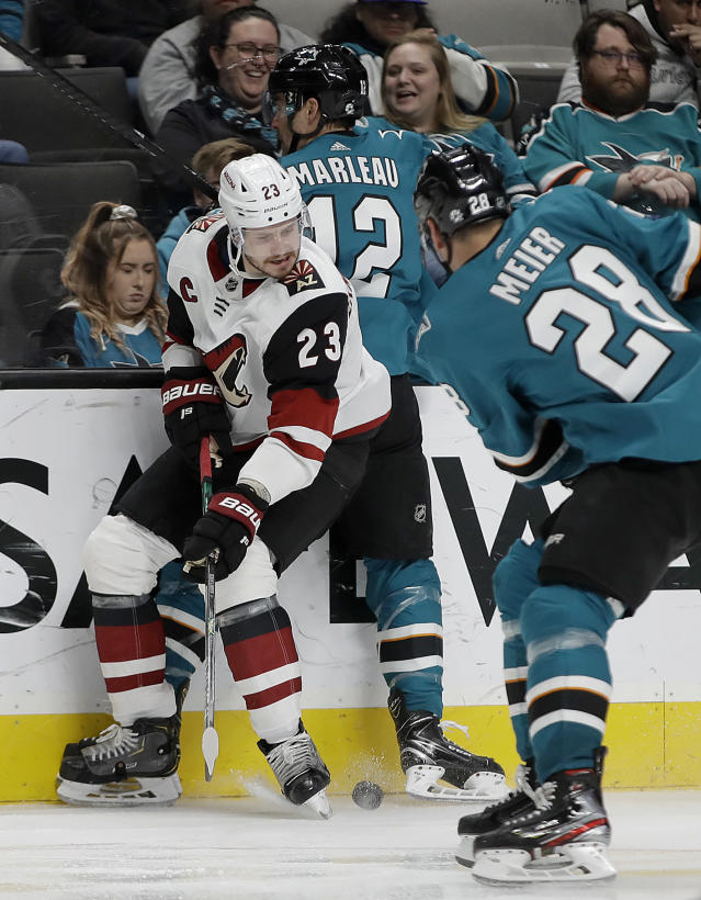 Arizona Coyotes' Oliver Ekman-Larsson, left, keeps the puck away from San Jose Sharks' Timo Meier (28) in the third period of an NHL hockey game, Tuesday, Dec. 17, 2019, in San Jose, Calif. (AP Photo/Ben Margot)