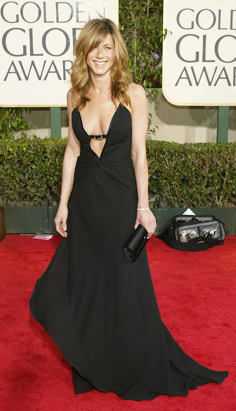"""<p>I'm sure we can all agree that Jennifer Aniston stunned in this sleek, sultry black gown. Fun fact: This was Aniston's last Golden Globes as Rachel from """"Friends,"""" so it's only right that she went out with a bang! (Image via Getty Images)</p>"""