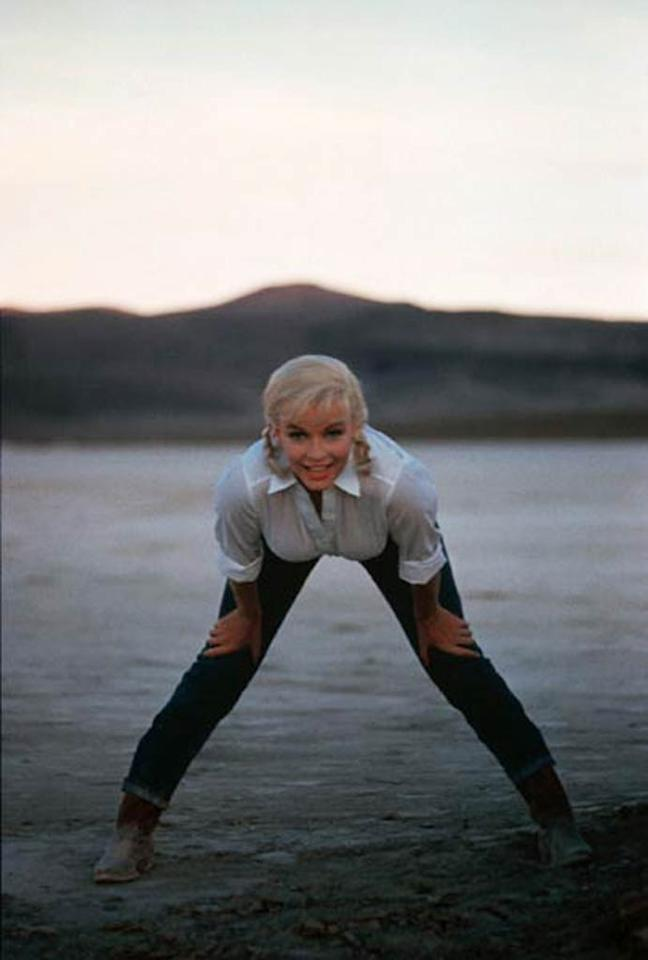 """<b>Marilyn Monroe in """"The Misfits,"""" 1961:</b> Marilyn Monroe demonstrated the appeal of jeans in some of her earliest photo shoots, later filling out a perfect pair of Levi's in the Western drama """"The Misfits."""" Decades after her death, Tommy Hilfiger purchased three pairs of her jeans at auction for $42,550, gifting one of the high-waisted, curvy pairs to sex symbol Britney Spears.   <b><a href="""" http://www.instyle.com/instyle/package/general/photos/0,,20185823_20339436_20730450,00.html?xid=omg-flattering-jeans?yahoo=yes"""" target=""""new"""">Find Your Most Flattering Jeans</a></b> Courtesy MGM - 1961"""