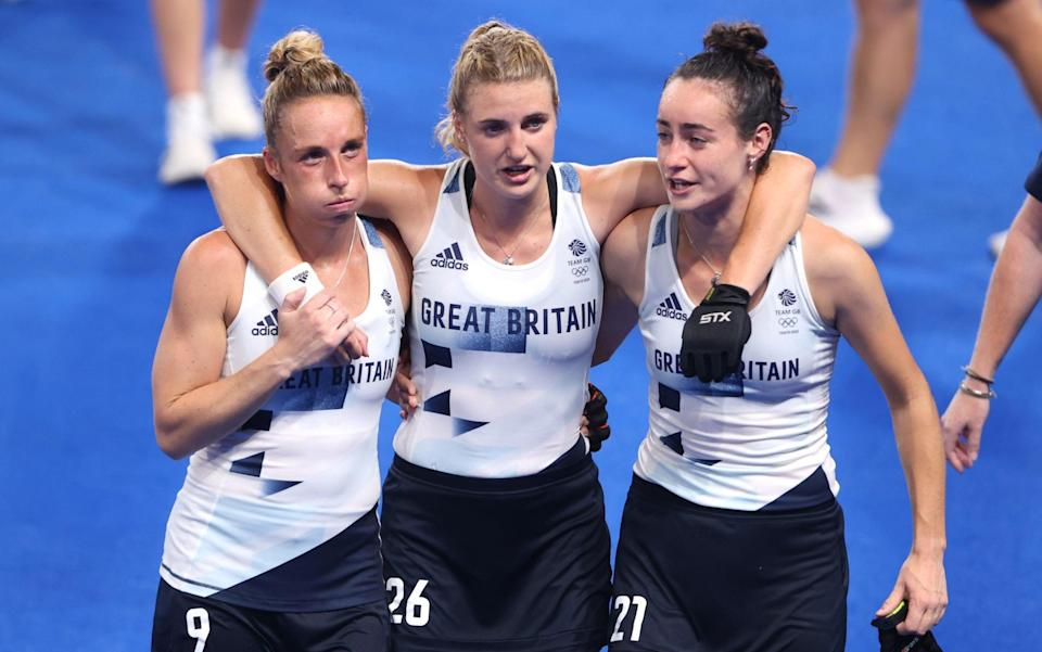 Susannah Townsend, Lily Owsley and Fiona Anne Crackles of Team Great Britain leave the pitch following victory over Spain - GETTY IMAGES