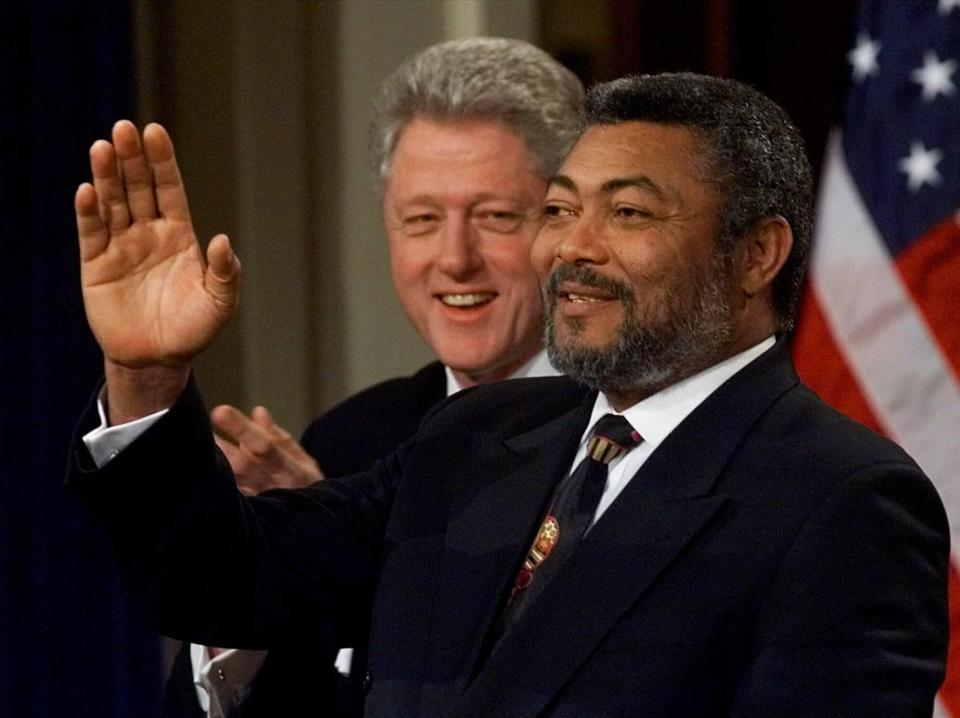 FILE - In this Wednesday, Feb. 24, 1999 file photo, Ghanaian President Jerry Rawlings, right, gestures with President Clinton looking over his shoulder during a news conference at the White House in Washington. Ghana's former president Jerry Rawlings, who staged two coups and later led the West African country's transition to a stable democracy, has died aged 73, according to the state's Radio Ghana and the president Thursday, Nov. 12, 2020. (AP Photo/Doug Mills, File)