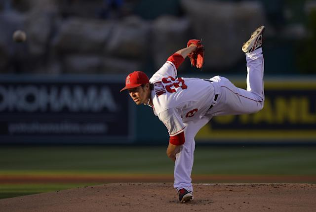 Los Angeles Angels starting pitcher C.J. Wilson throws to the plate during the first inning of their baseball game against the Seattle Mariners, Wednesday, June 19, 2013, in Anaheim, Calif. (AP Photo/Mark J. Terrill)