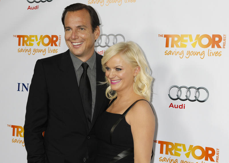 """Actor Arnett and his wife actress Poehler arrive at The Trevor Project's """"Trevor Live"""" fundraising dinner in Hollywood"""