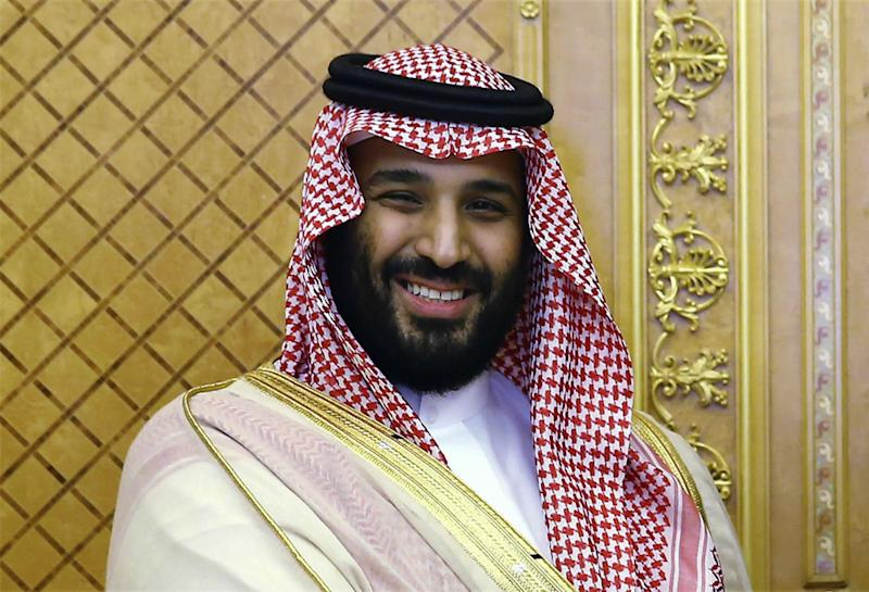 FILE - In this July, 23, 2017 file photo, Saudi Crown Prince Mohammed bin Salman poses while meeting with Turkey's President Recep Tayyip Erdogan in Jiddah, Saudi Arabia. Iran's top regional foes, Israel and Saudi Arabia, are both watching that country's protests for signs they could lead to change. Iran's supreme leader has accused enemies of stoking the unrest. (Presidency Press Service/Pool Photo via AP, File)