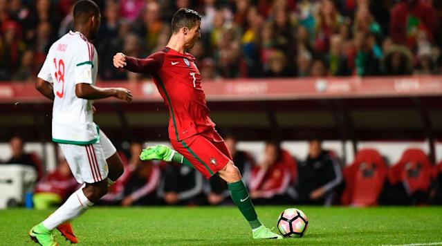 Cristiano Ronaldo added to his national goals record for Portugal, scoring twice for the reigning European champions in a 3-0 win over Hungary in World Cup qualifying on Saturday.