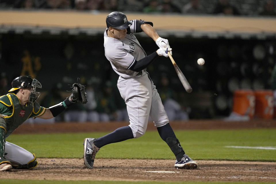 New York Yankees' Aaron Judge hits an RBI single against the Oakland Athletics during the eighth inning of a baseball game Thursday, Aug. 26, 2021, in Oakland, Calif. (AP Photo/Tony Avelar)