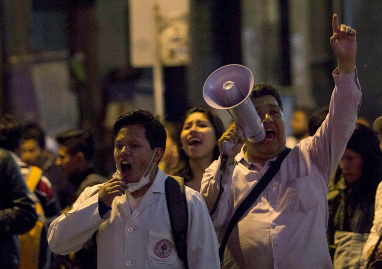 Healthcare employees shout slogans during a protest against Bolivia's government policy regarding healthcare system, in La Paz, Bolivia, December 15, 2017. REUTERS/Luis Salazar