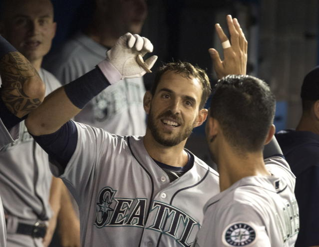 Seattle Mariners' Austin Nola celebrates in the dugout with teammates after hitting a solo home run during fourth-inning baseball game action against the Toronto Blue Jays in Toronto, Saturday, Aug. 17, 2019. (Fred Thornhill/The Canadian Press via AP)
