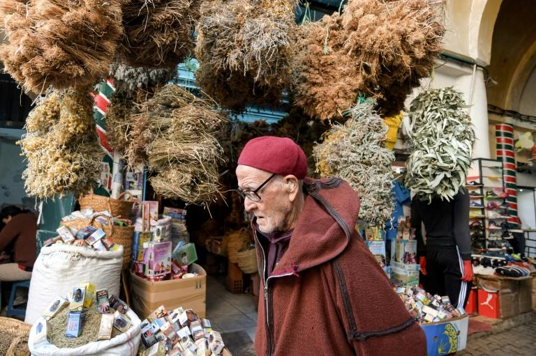 Tunisians flock to the Souk el-Blat in Tunis and its herbalist stalls, where flasks, powders and dried herbs are stacked high