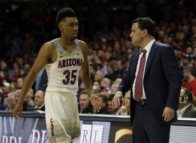 "Arizona head coach Sean Miller and <a class=""link rapid-noclick-resp"" href=""/ncaab/players/131287/"" data-ylk=""slk:Allonzo Trier"">Allonzo Trier</a> (35) in the first half during an NCAA college basketball game against Stanford, Thursday, March 1, 2018, in Tucson, Ariz. (AP)"