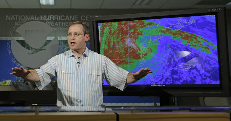 James Franklin, Branch Chief of Hurricane  Forecast Operations, gestures as he talks to a reporter at the National Hurricane Center in Miami, Thursday, April 4, 2013. The National Weather Service is now changing how it issues hurricane and tropical storm warnings. Starting June 1, watches and warning will be issued for storms that threaten life and property even after they are no longer hurricanes or tropical storms. (AP Photo/Alan Diaz)