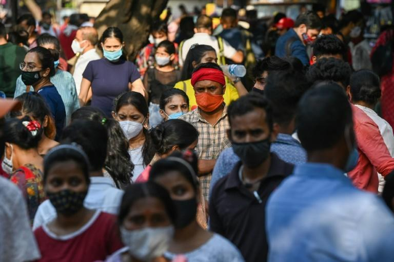 As a devastating coronavirus wave has eased, Indians have thronged markets and malls in many cities