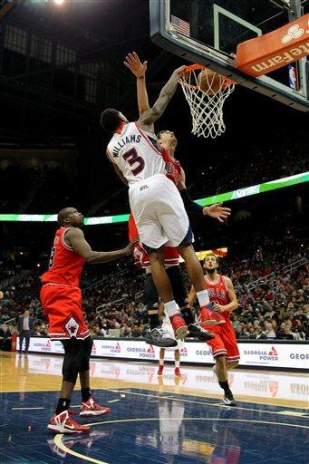 Atlanta Hawks shooting guard Louis Williams (3) dunks in the first half of an NBA basketball game against the Chicago Bulls, Saturday, Dec. 22, 2012, in Atlanta. (AP Photo/Todd Kirkland)