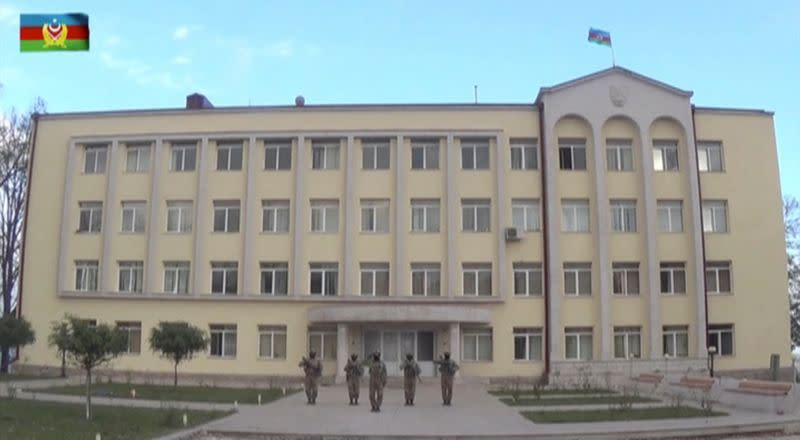 A still image shows what is said to be Azeri service members in front of an administrative building in Shushi