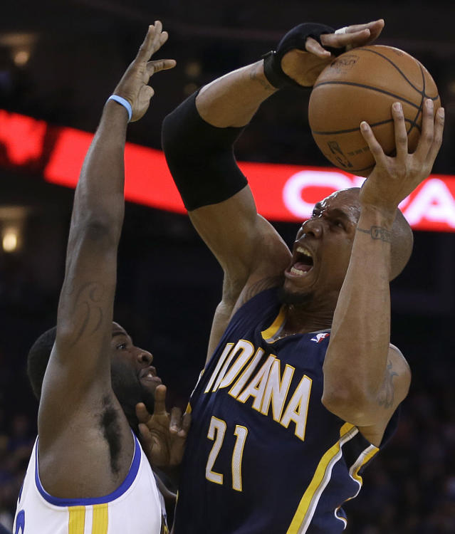 Indiana Pacers' David West, right, looks to shoot over Golden State Warriors' Draymond Green during the second half of an NBA basketball game Monday, Jan. 20, 2014, in Oakland, Calif. (AP Photo/Ben Margot)