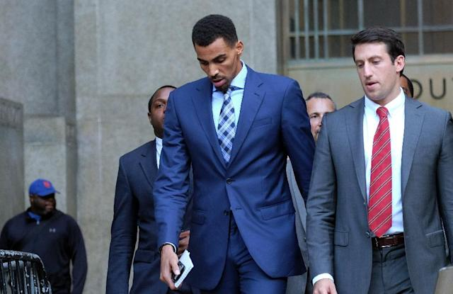 This photo taken on October 7, 2015 shows Atlanta Hawks forward Thabo Sefolosha (C) leaving the courthouse after attending his trial in New York (AFP Photo/JEWEL SAMAD)