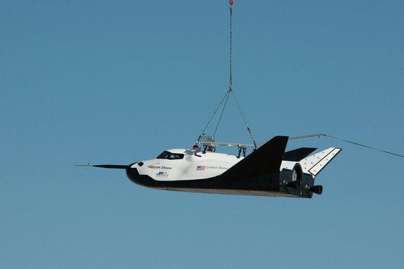 NASA partner Sierra Nevada Corporation (SNC) of Louisville, Colo., performs a captive-carry test of the Dream Chaser spacecraft Thursday at NASA's Dryden Flight Research Center in Edwards, Calif.