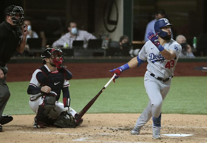 Dodgers designated hitter Edwin Ríos hits a home run during the third inning of Game 4 of the NLCS.