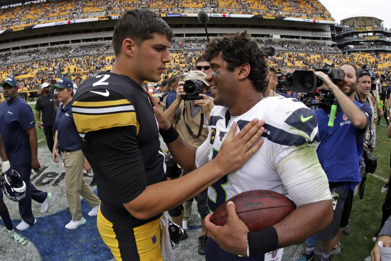 Seattle Seahawks quarterback Russell Wilson (3) visits with Pittsburgh Steelers quarterback Mason Rudolph (2) after an NFL football game in Pittsburgh, Sunday, Sept. 15, 2019. (AP Photo/Gene J. Puskar)