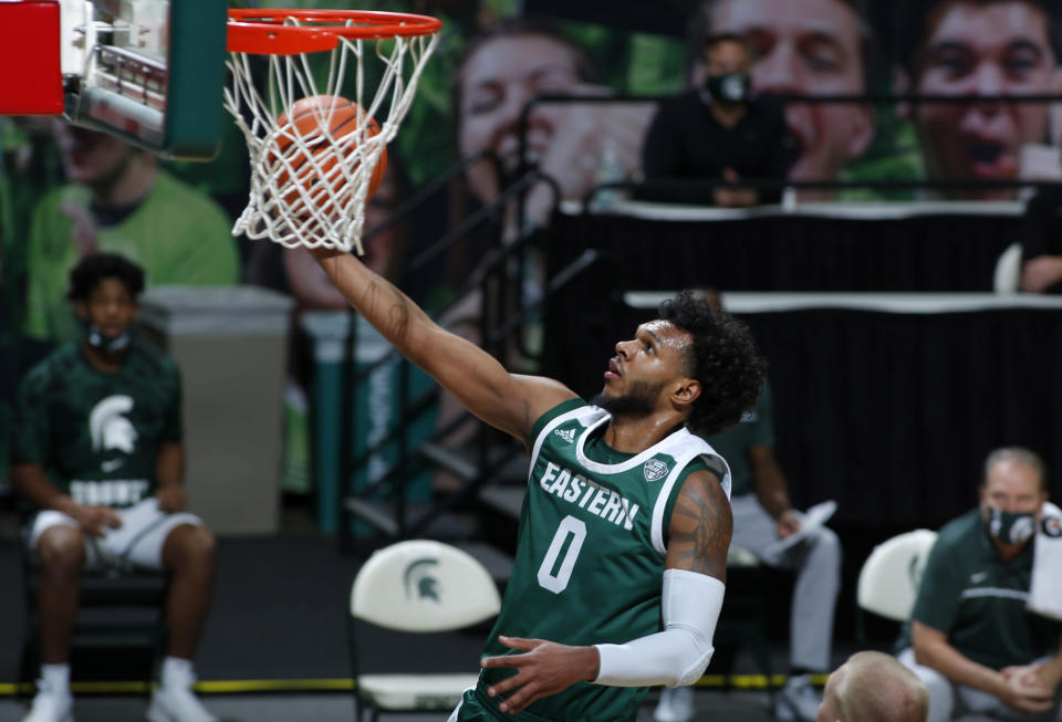 Eastern Michigan's Yeikson Montero goes up for a layup against Michigan State during the first half of an NCAA college basketball game, Wednesday, Nov. 25, 2020, in East Lansing, Mich. (AP Photo/Al Goldis)