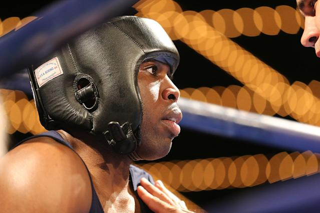 <p>NYPD officer Jamaal Spence gets instructions in his corner during the NYPD Boxing Championships at the Theater at Madison Square Garden on June 8, 2017. (Photo: Gordon Donovan/Yahoo News) </p>