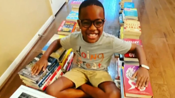 Orion Jean, 10, is on a mission to share his love of reading with others. / Credit: Family Handout