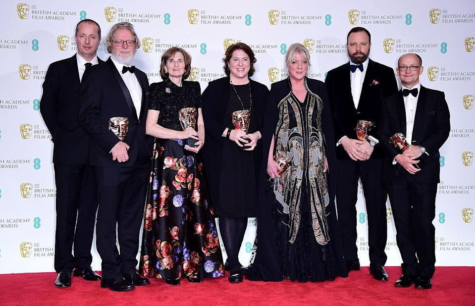 The crew of The Favourite after winning the Outstanding British Film Bafta in the press room at the 72nd British Academy Film Awards. (Ian West/PA)