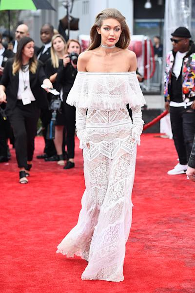 Before cohosting, Gigi Hadid stunned in a lace dress on the red carpet at the American Music Awards 2016 in L.A. on Sunday, November 20 — see the style here!
