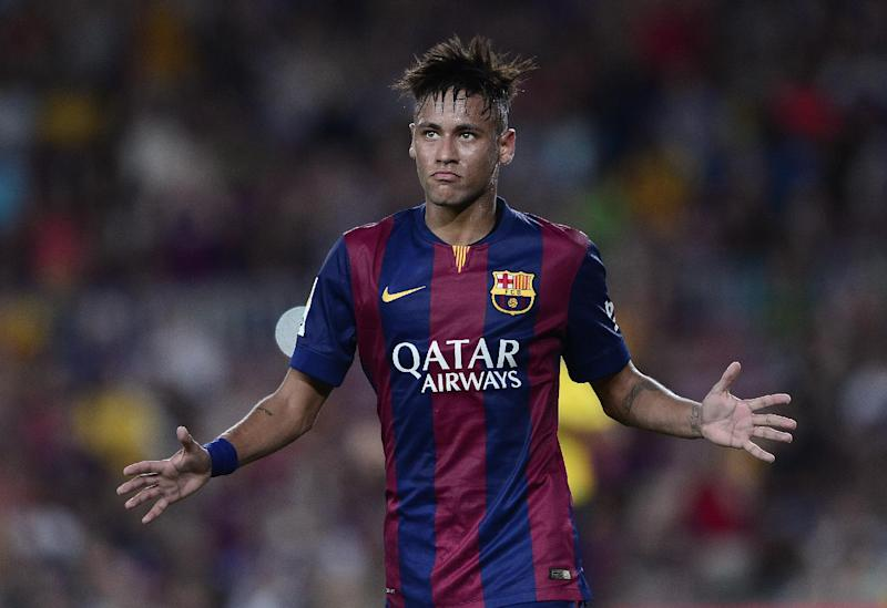 Barcelona's Brazilian forward Neymar celebrates his goal during the 49th Joan Gamper Trophy match against Leon Club at the Camp Nou stadium in Barcelona on August 18, 2014