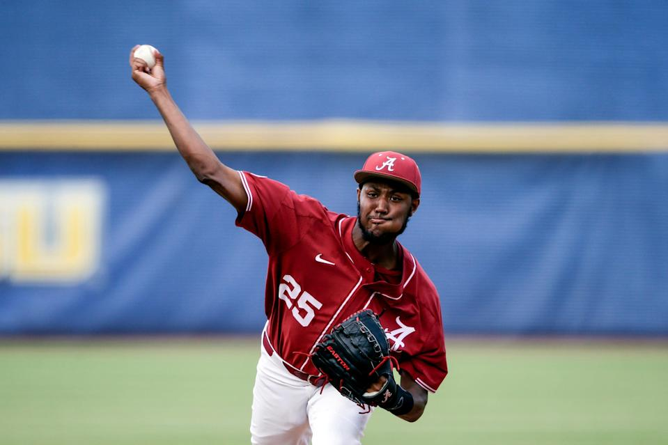 Alabama pitcher Dylan Smith throws against Florida in the first inning during the Southeastern Conference tournament in Hoover, Ala. on May 27, 2021.