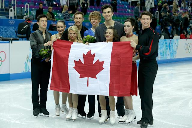 SOCHI, RUSSIA - FEBRUARY 09: (L-R) Silver medalists Patrick Chan, Kaetlyn Osmond, Kirsten Moore-Towers, Dylan Moscovitch, Kevin Reynolds, Eric Radford, Meagan Duhamel, Tessa Virtue and Scott Moir of Canada celebrate during the flower ceremony for the Team Figure Skating Overall during day two of the Sochi 2014 Winter Olympics at Iceberg Skating Palace onon February 9, 2014 in Sochi, Russia. (Photo by Darren Cummings/Pool/Getty Images)
