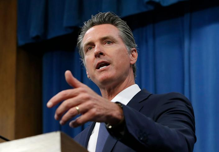 FILE - In this July 23, 2019, file photo, Gov. Gavin Newsom talks to reporters at his Capitol office, in Sacramento, Calif. California could become the first state with its own prescription drug label. Newsom announced Thursday, Jan. 9, 2020, he wants California to contract with generic drug companies to make prescription medications on behalf of the state so it can sell them to the public. He said the goal is to lower prices by increasing competition in the generic market. State lawmakers must approve the plan before it can take effect. (AP Photo/Rich Pedroncelli, File)