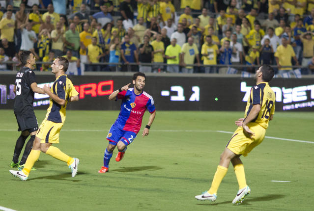 FC Basel Mohamed Salah, center, celebrates after scoring his team's second goal against Maccabi Tel Aviv FC during the Champions League third qualifying round second leg soccer match at the Bloomfield stadium in Tel Aviv, Israel, Tuesday, Aug. 6, 2013. (AP Photo/Ariel Schalit)