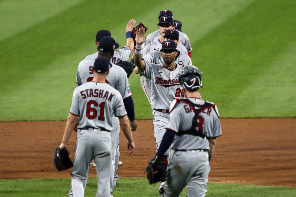 The Minnesota Twins celebrate the team's 10-5 win over the Chicago White Sox after a baseball game, Friday, July 24, 2020, in Chicago. (AP Photo/Charles Rex Arbogast)