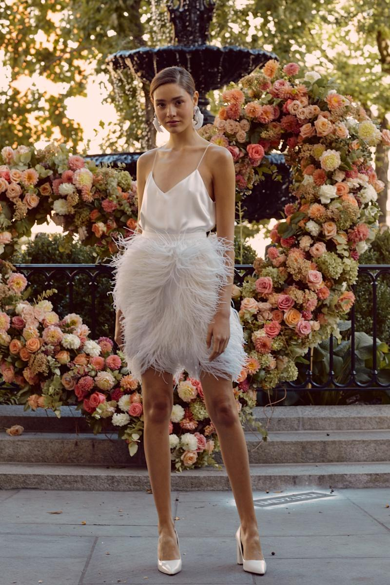 "Lela Rose introduced a ""ready-to-wed"" collection of traditional gowns and more casual pieces to wear to the rehearsal dinner or reception, like this feathered miniskirt and camisole."