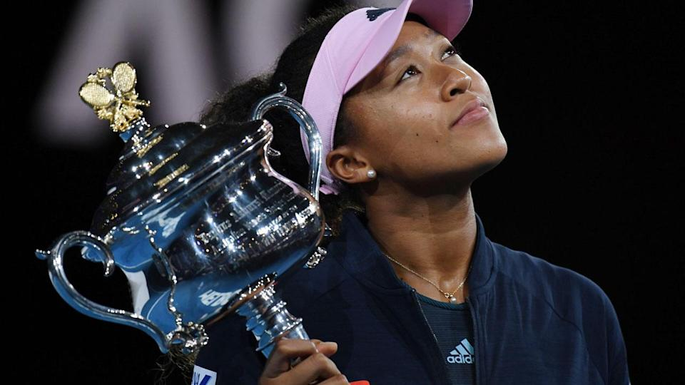 Naomi Osaka holds aloft her second grand slam trophy – the Daphne Akhurst Memorial Cup. Pic: Getty