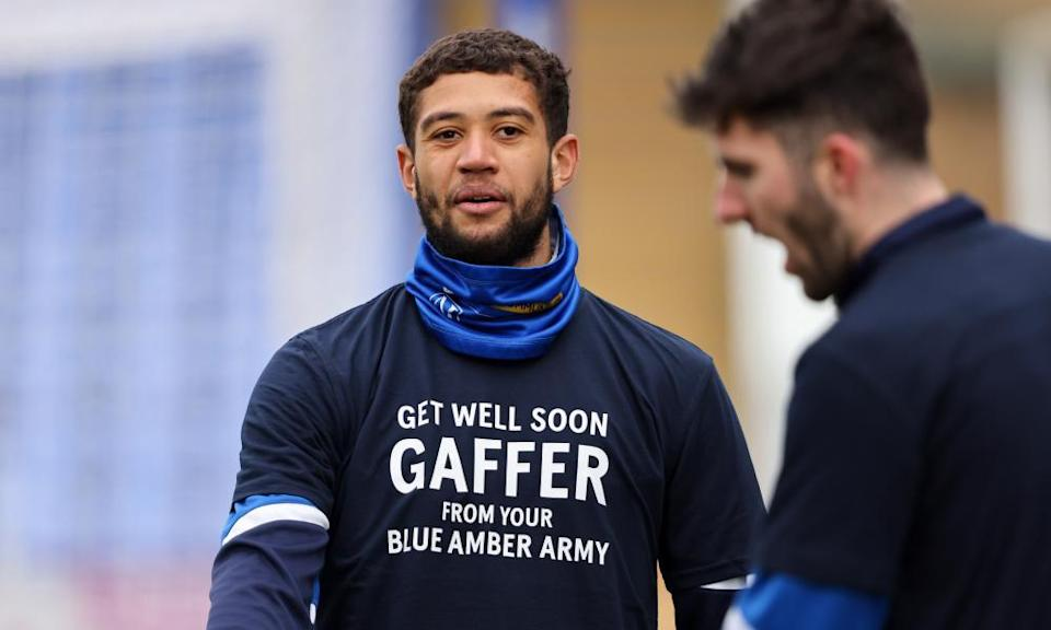 Shrewsbury forward Rekeil Pyke in a T-shirt with a message for manager Steve Cotterill.
