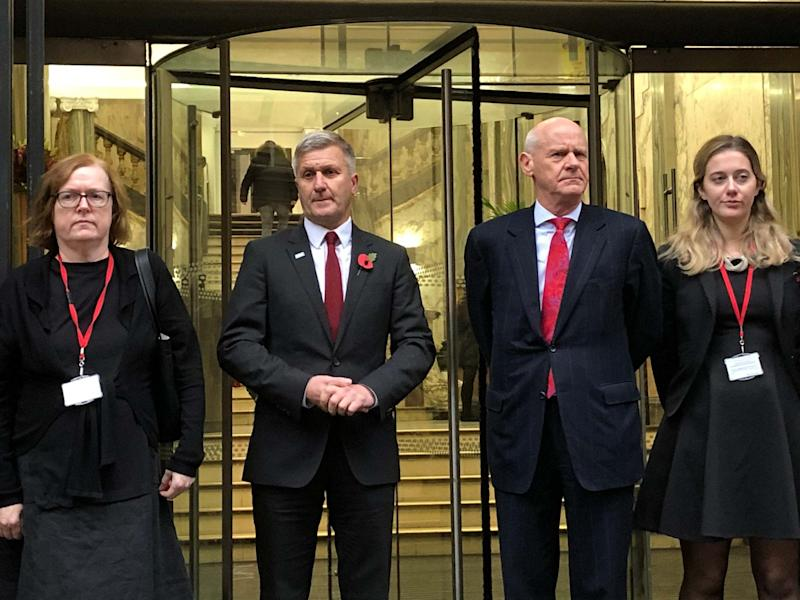 Dr Richard Freeman, second left, outside the tribunal in Manchester: PA