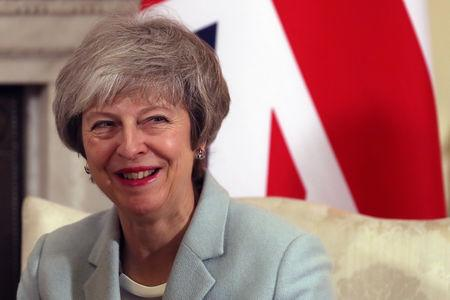 Britain's Prime Minister Theresa May reacts during her meeting with Malta's Prime Minister Joseph Muscat inside 10 Downing Street in central London