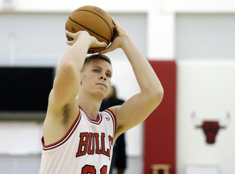 Chicago Bulls NBA basketball draft pick Erik Murphy, shoots hoops in his new uniform at the Berto Center Monday, July 1, 2013, in Deerfield, Ill. The Bulls selected Tony Snell with the 20th pick out of New Mexico, and Murphy with the 49th pick out of Florida. (AP Photo/M. Spencer Green)