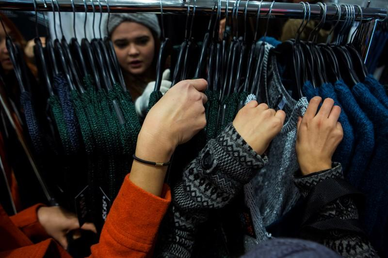 People shop at H&M on Thanksgiving Day in New York