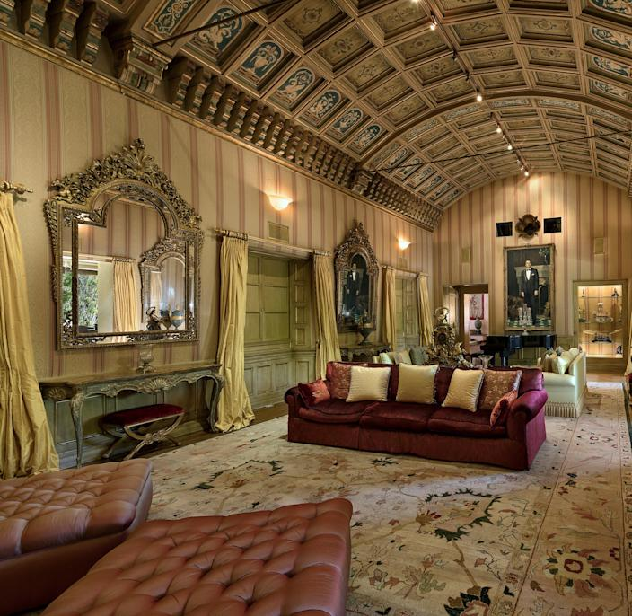 The formal living room features 22-foot-high hand-painted arched ceilings.