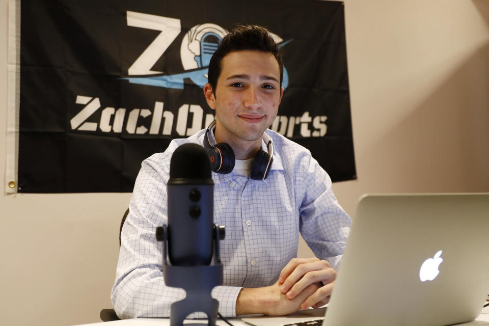 Zach Gershman, a Penn State sophomore, poses for a photograph in his basement studio, Thursday, Aug. 6, 2020, in Philadelphia. Gershman lost a paid summer internship covering The Northwoods collegiate baseball league for local Fox Sports affiliates in the Midwest. (AP Photo/Matt Slocum)