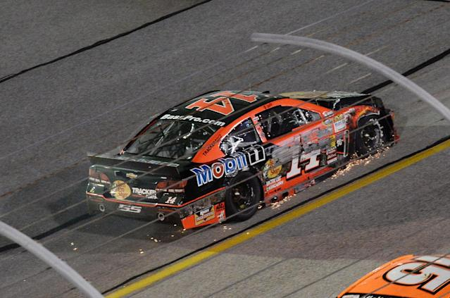 Sprint Cup Series driver Tony Stewart (14) drives his damaged car to the garage after hitting the wall during a NASCAR Sprint Cup auto race at Atlanta Motor Speedway Sunday, Aug. 31, 2014, in Hampton, Ga.. (AP Photo/Joe Sebo)